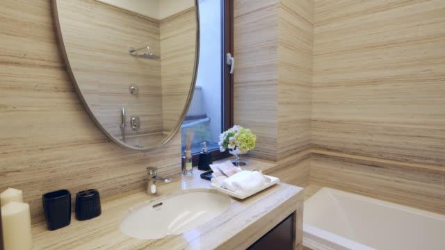 interior of modern washroom 4k interior of modern washroom 4k bathroom stock videos & royalty-free footage