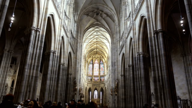 interior of st vitus cathedral and visitors - church architecture stock videos & royalty-free footage