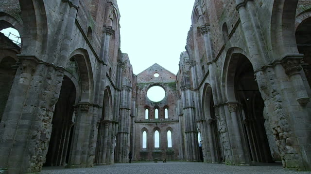 Interior of the abbey of San Galgano in 4k December 2018. View of the external part of the ruins of the Abbey of San Galgano. Church in Gothic style abandoned since 1800. We are on a cold winter Sunday. December 2018 in Siena high dynamic range imaging stock videos & royalty-free footage