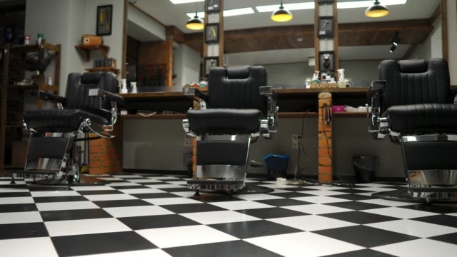 Magnificent Interior Of The Mens Barber Shop With Brick Walls And Ibusinesslaw Wood Chair Design Ideas Ibusinesslaworg