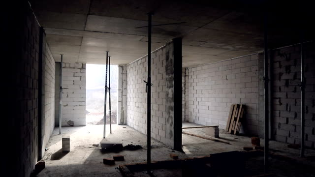 interior of the unfinished building of the room. construction of gas blocks and internal partitions between the rooms - kitchen room video stock e b–roll