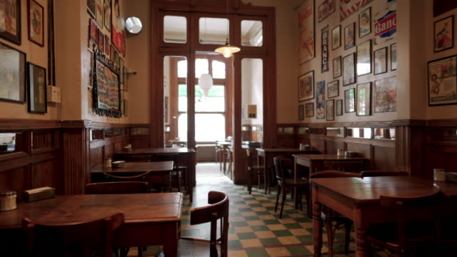 interior of traditional coffee shop in buenos aires - space video stock e b–roll