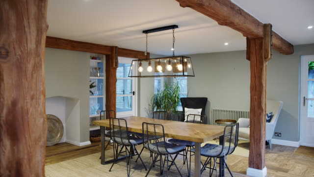 Interior view of beautiful dining room with table and chairs in family home - shot in slow motion
