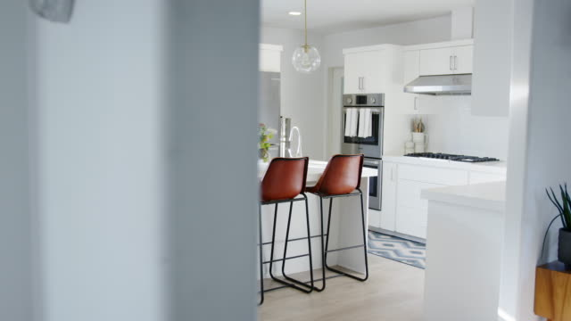 Interior View Of Beautiful Kitchen With Island Counter In New Family House video