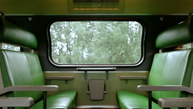 Interior view of modern passenger train Interior view of modern passenger train seat stock videos & royalty-free footage
