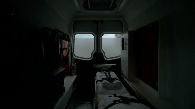 Internal view of a modern ambulance car riding on the street. Interior, modern special equipment, seat and stretcher video