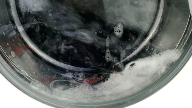 internal view of a washing machine drum. close-up - veicolo a due ruote video stock e b–roll