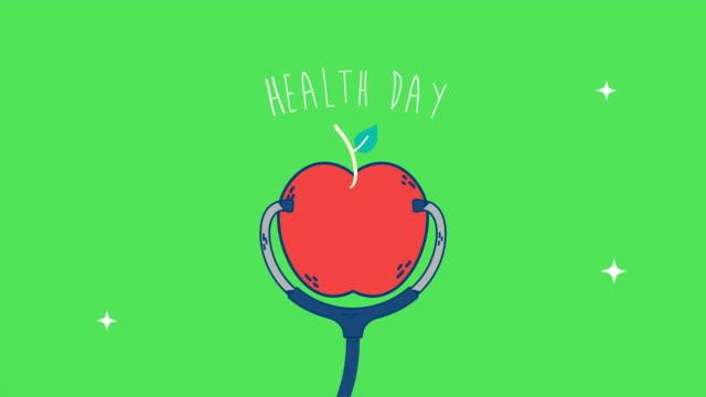 リンゴと聴診器を使った国際保健デー - 聴診器点の映像素材/bロール