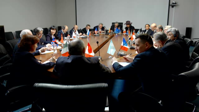 international negotiations for a round table. statesman or politicians are seriously discussing the problem of ecology - democrazia video stock e b–roll