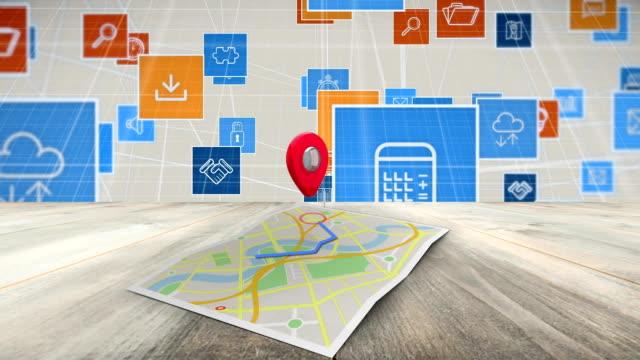 icone internet su una mappa di google - carta geografica video stock e b–roll