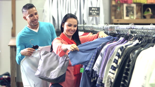 Interracial couple shopping in clothing store video