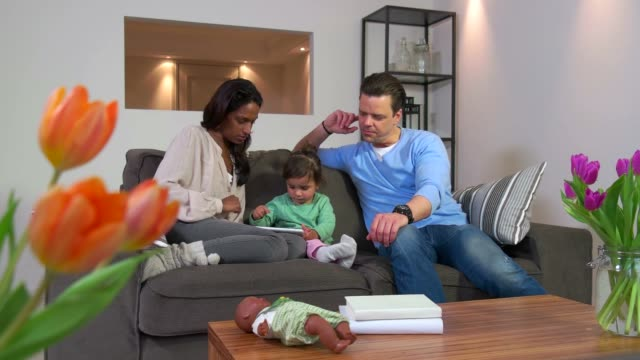 Interracial Married Couple Playing With Daughter Using Ipad At Home video