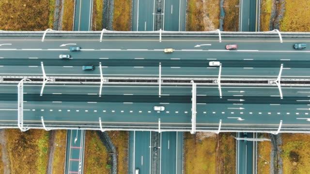 intersecting freeways and wide overpass highways aerial view - vídeo