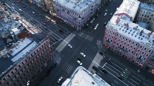 Intersection of two multi-lane roads. Intersection of two multi-lane roads. Hurrying cars and city buses. treedeo saint petersburg stock videos & royalty-free footage