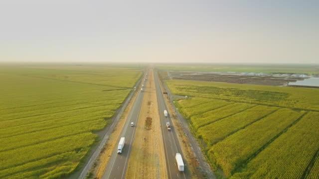 Interstate Running Between Farms - Aerial Shot video
