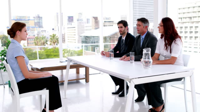Interview panel speaking with young applicant Interview panel speaking with young applicant in the office job interview stock videos & royalty-free footage