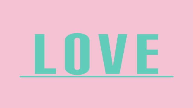 """love"" intro graphics in teal against pink - kobiecość filmów i materiałów b-roll"