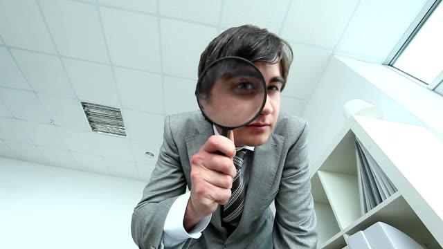 investigator - lupe stock-videos und b-roll-filmmaterial