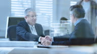 istock DS Investor and senior architect shaking hands after signing contract 485766334