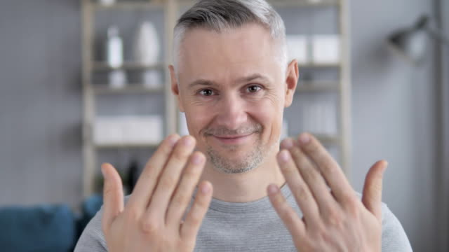 inviting gesture by gray hair man - temptation stock videos & royalty-free footage