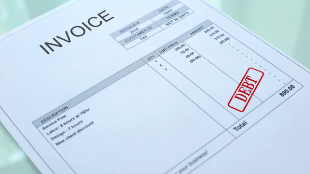 Invoice debt, hand stamping seal on commercial document, business payment