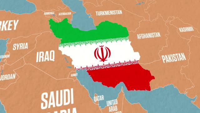 vídeos de stock, filmes e b-roll de mapa do irã e sinalizar no mapa do mundo - país área geográfica