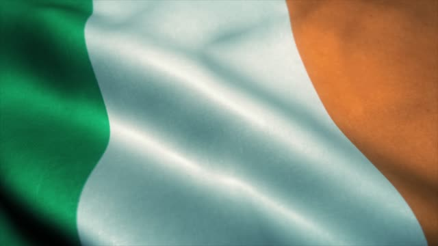Ireland flag waving in the wind. National flag of Ireland. Sign of Ireland seamless loop animation. 4K