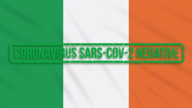 Ireland swaying flag with a green stamp of freedom from coronavirus, loop