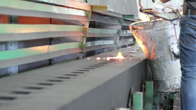 iron molten metal pouring in sand mold - industria metallurgica video stock e b–roll
