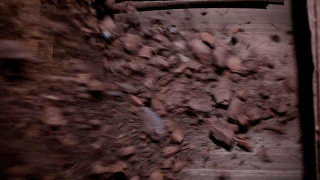 Iron ore falls on conveyor belt video