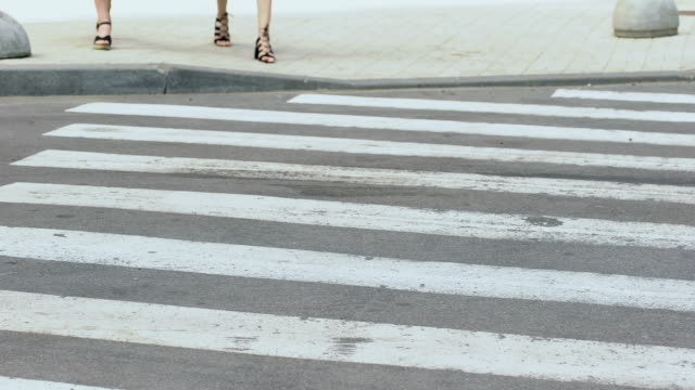 vídeos de stock e filmes b-roll de irresponsible driver run over girls on pedestrian crossing, traffic violation - dar murros