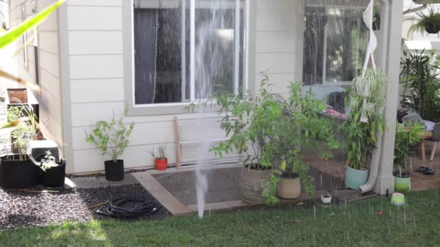 Irrigation system is leaking. Sprinkler system leak in garden.