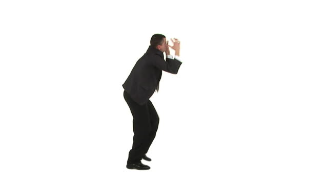 HD: Irritated Businessman HD1080i: Businessman gesturing wildly,  stamping and acting all irritated while standing isolated on a white background. Wide shot, profile view. stamping feet stock videos & royalty-free footage