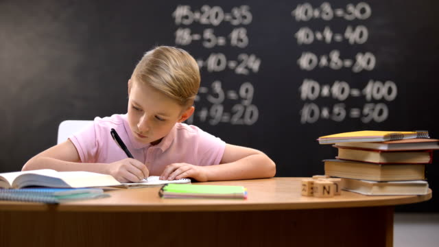 Irritated schoolboy tearing page from notebook, unable to solve difficult task Irritated schoolboy tearing page from notebook, unable to solve difficult task mathematics stock videos & royalty-free footage