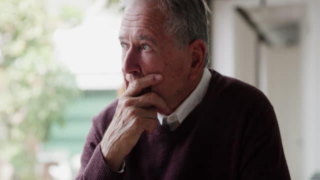 vídeos de stock e filmes b-roll de is it too late for maybes? - old men window