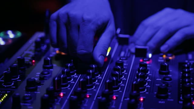 DJ is playing music on a festival - Hands close up DJ is playing music on a festival, Close up shoot on his hands while he is adjusting knob dials. hip hop stock videos & royalty-free footage