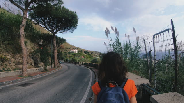 ischia island. a girl walks around the island of ischia. italy. - procida video stock e b–roll