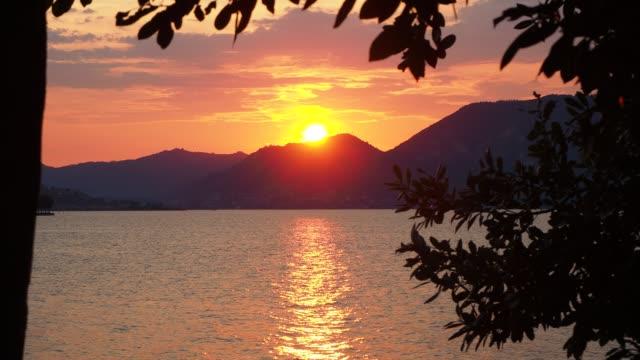 Iseo, Brescia, Italy. Amazing warm sunset at Iseo lake