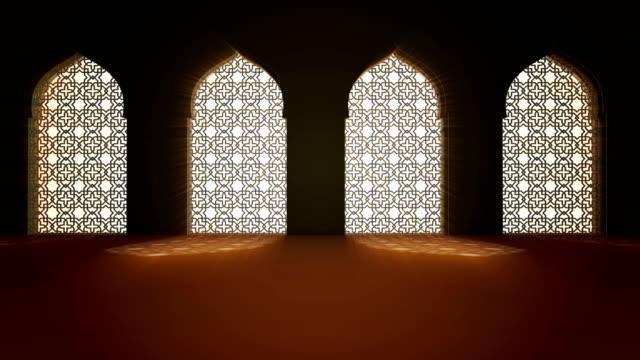 islamic interior mosque window or door with beam of ray light coming inside . ramadan kareem islamic motion background. 3d animation. - ramadan kareem стоковые видео и кадры b-roll