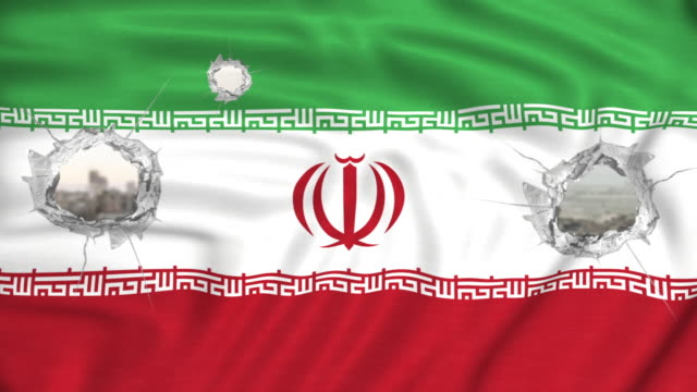 Islamic Republic of Iran flag with bullet holes