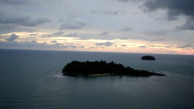 Island at sunset video
