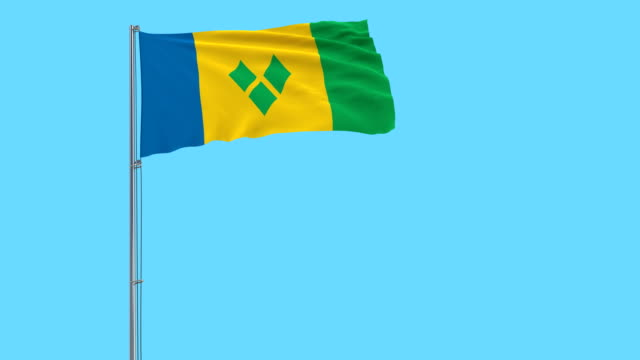 isolate flag of saint vincent and the grenadines on a flagpole fluttering in the wind on a blue background, 3d rendering - kingstown video stock e b–roll