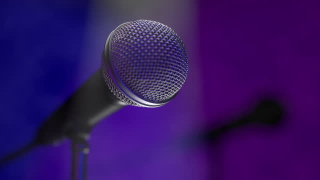 Isolated concert microphone close-up on an empty stage for artist's performance