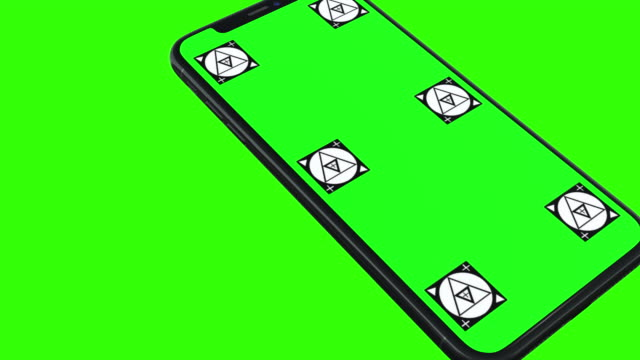 Isolated Smart Phone with Green Screen Blank green screen isolated smart phone turns on green background specially designed for promote their new mobile phone application or company website. electronics store stock videos & royalty-free footage