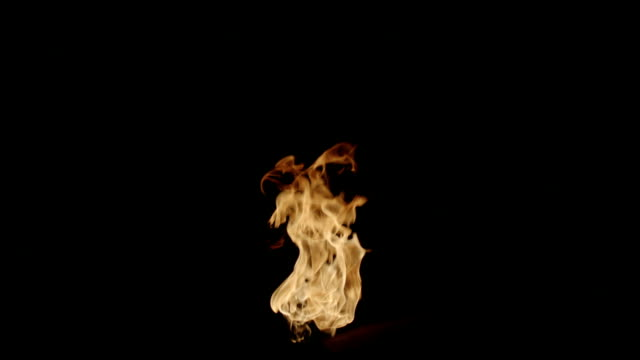 isolated strong flame shot on black - fiamma video stock e b–roll