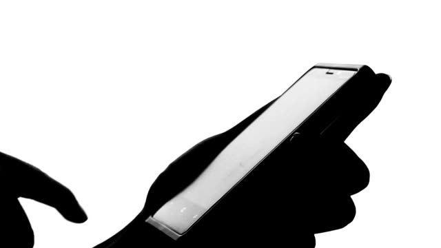 isolated:Typing smart phone Silhouette video