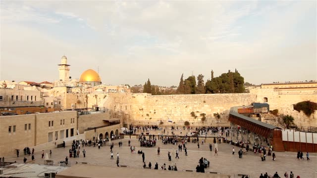 Israel, Jerusalem western wall. The Western Wall, Wailing Wall, Jewish shrine, old city of Jerusalem, Orthodox Jews pray, religion, Timelapse, zoom, panorama video