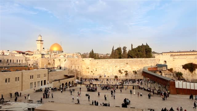 Israel, Jerusalem western wall. The Western Wall, Wailing Wall, Jewish shrine, old city of Jerusalem, Orthodox Jews pray, religion, Timelapse, zoom, panorama video