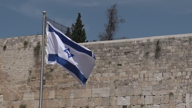 Israel national flag fly in Western Wall  Jerusalem video