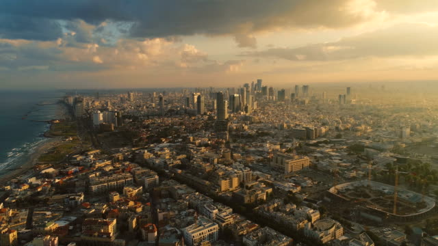 Israel skyline from a drone Early morning sunrise. Panoramic Aerial view above coastline of Tel Aviv modern and business city with hotels, seashore and beach. Middle east skylines